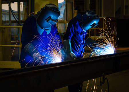 mig: MIG welder uses torch to make sparks during manufacture of metal equipment.
