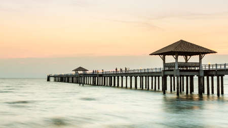 mujeres: Wood jetty on the Beach and tropical sea,East of Thailand.