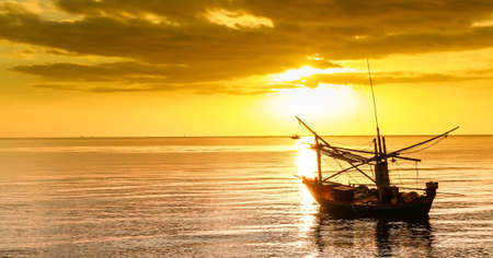 Fishing boat at sunset Stock Photo - 19665612