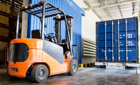 warehouse equipment: Forklift in warehouse with container Stock Photo