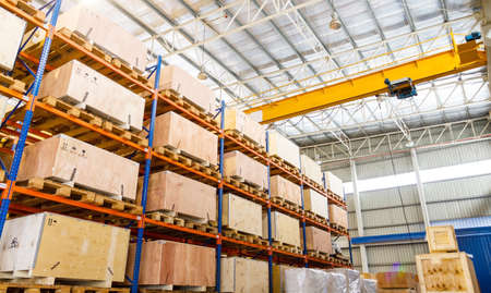 Shelves and racks in distribution warehouse interior  photo