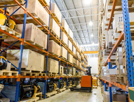 Modern warehouse with forklifts photo