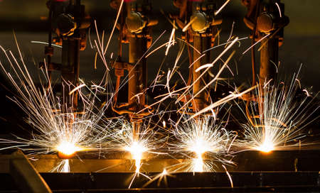 production line factory: CNC LPG cutting with sparks close up