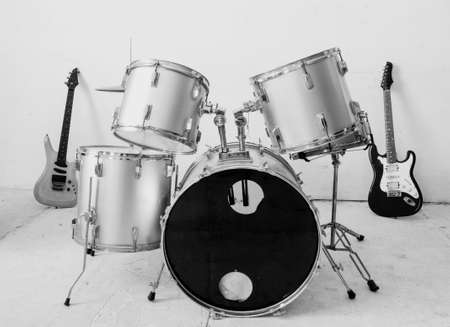 Guitar and drum kit photo