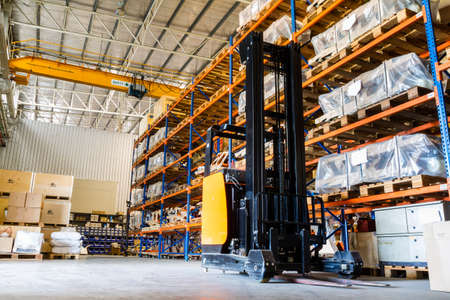 Modern warehouse with forklifts  Редакционное
