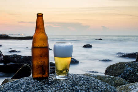 Beer bottle on the beach photo