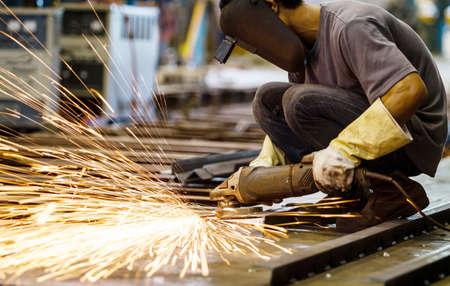welding machine: Metal grinding on steel plate Stock Photo