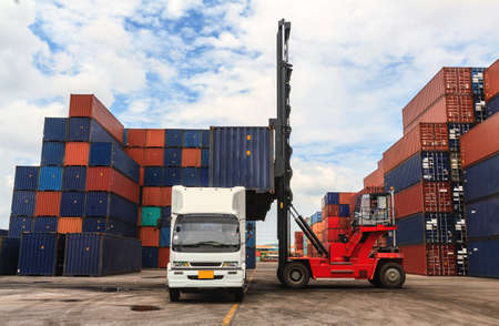land transportation: Stack of Freight Containers at the Docks with Truck