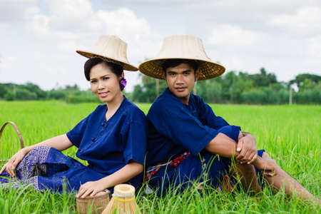 Thai farmer on rice fields photo