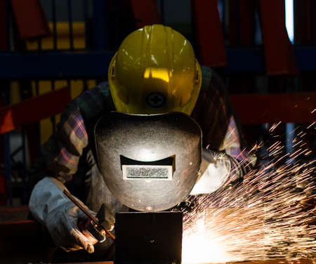 skilled labour: Gouging welding metal