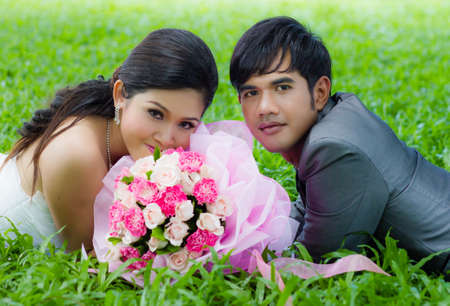 Couples of groom and bride with bouquet flowers photo