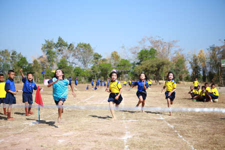 10 to 12 years: PHOCHAI,ROI-ET - JANUARY 10 : Unidentified Thai students 4 - 12 years old athletes in action during sport day on January 10, 2014 in Ban Donrue school, Phochai, Roi-Et, Thailand.