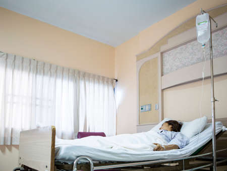 Woman patient in hospital bed  Stock Photo