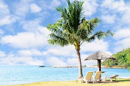 Liegestuhl mit sonnenschirm strand  Beach Chair And Umbrella On Sand Beach Lizenzfreie Fotos, Bilder ...