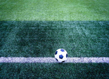 ballsport: Soccer ball on soccer field  Stock Photo