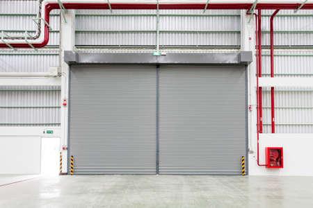 shutter: Interior of factory with shutter door
