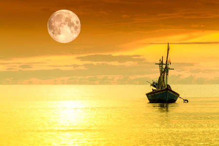 Sailboat and full moon photo