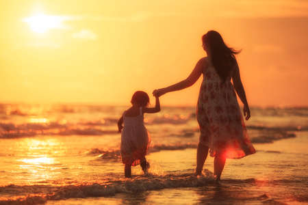 Mother with her daughter on the beach photo