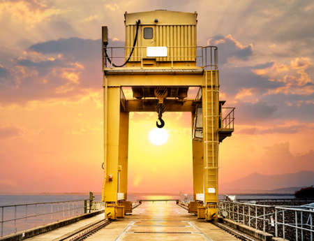 overhead crane: Large Gantry Crane on Sunset at Ubonrat Dam, khonkaen, Thailand Stock Photo