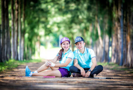 accomplices: Portrait of a couple in golf clothes Stock Photo