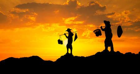Thai farmer on sunset photo