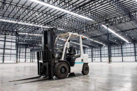 shipping supplies: Forklift loader in large modern storehouse