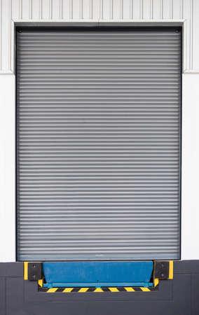 leveler: Dock leveler and shutter door, use for product transfer to truck. Stock Photo
