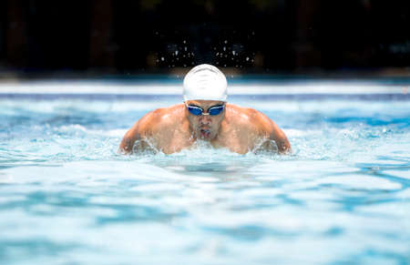 swim goggles: Swimmer in cap and glasses in swimming pool