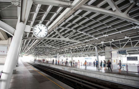 delhi: Train station background,Bangkok, Thailand (Focus on clock) Stock Photo