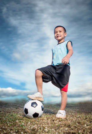 Child soccer player on soccer field