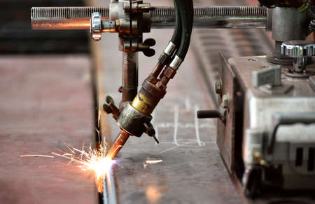 lasercutting: LPG cutting with sparks close up