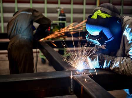 welding metal: Welder in a factory
