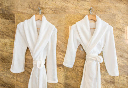 robes: White bathrobe on hanger