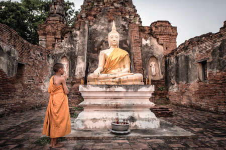 novice: Buddha statue and Novice  in Ayutthaya Thailand Stock Photo