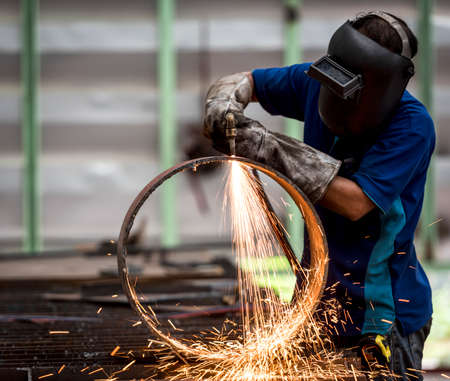 metal worker: metal cutting with acetylene torch (Focus on Torch) Stock Photo