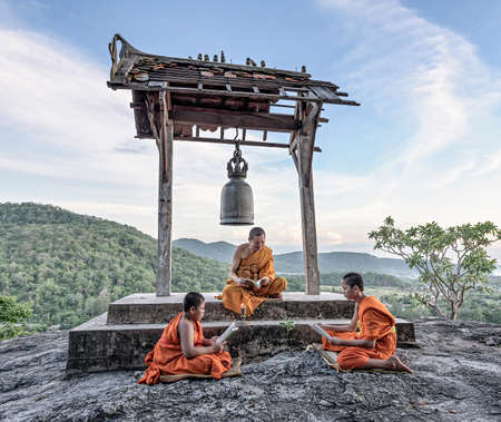 thai monk: Young novice monks learning Stock Photo