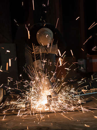 cutting metal: Worker cutting metal, Sparks while grinding iron