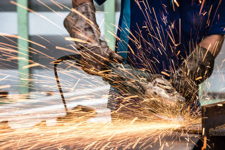 steel structure: Electric wheel grinding on steel structure in factory Stock Photo