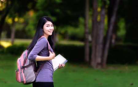 backpack: Asian woman college student on campus