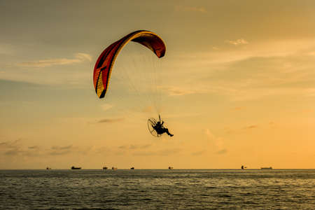 paragliding: Silhouette of paragliding