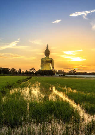 budda: The Biggest Buddha Image In Thailand Under Sunrise