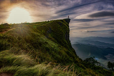 Sunrise scene with the peak of mountain and cloudscape at Phu chi fa in Chiangrai,Thailand photo