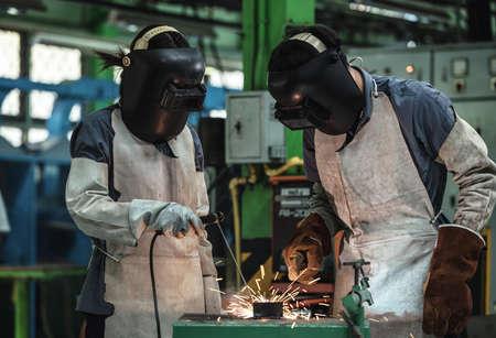 woman work: Industrial welder worker at factory workshop