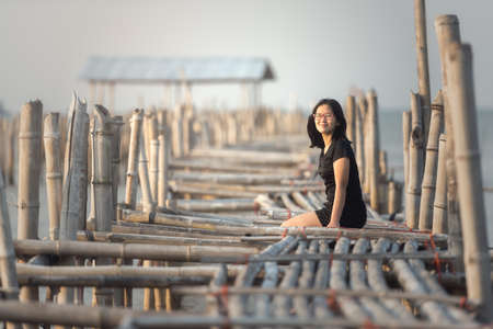 wonderful: Woman sitting on Bamboo bridge