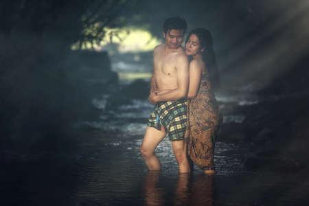 adult vietnam: Asian couple bathing at cascade (Vintage color)