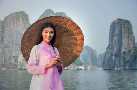 traditional: Portrait of Vietnamese girl traditional dress at Halongbay, Vietnam Stock Photo