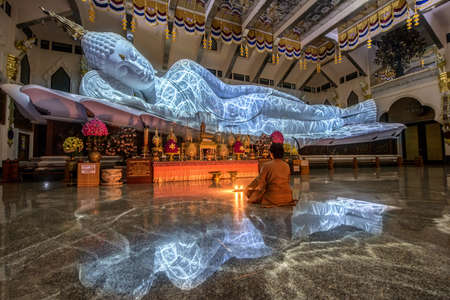 The biggest white marble nirvana buddha with the texture from lighting at Wat Pa Phu Kon, Udon Thani Thailand
