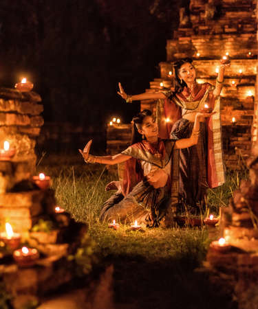 thai dancing: Thai dancing girl in Ayutthaya style dress with candle at night