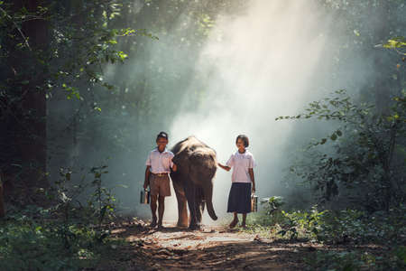 Student little asian boy and girl, countryside in Thailand 写真素材