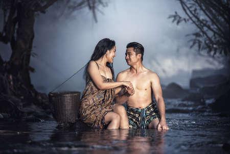 cascade: Asian couple bathing at cascade